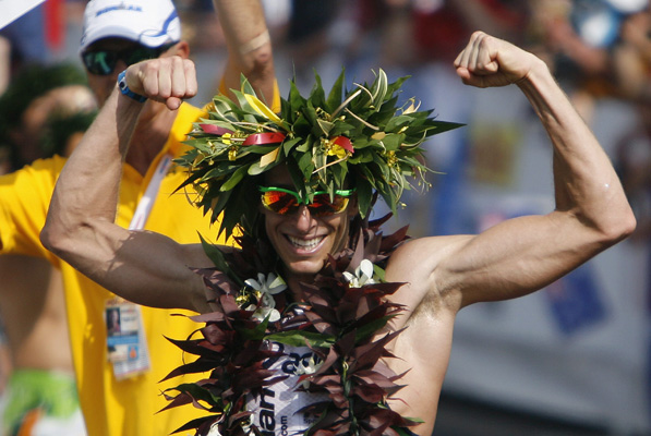 Professional triathlete Pete Jacobs of Australia celebrates after winning the Ironman World Championship triathlon in Kailua-Kona, Hawaii